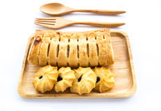 Pineapple pie and cookies in wooden plate on white background Stock Photography