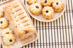 Pineapple pie and cookies in wooden plate on wooden table Royalty Free Stock Photography