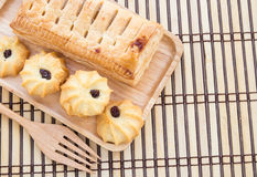 Pineapple pie and cookies in wooden plate on wooden table Stock Photography
