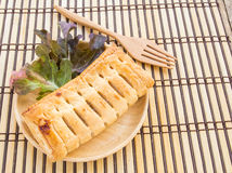 Pineapple pie and lettuce in wooden plate Stock Photos