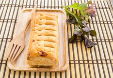 Pineapple pie and lettuce in wooden plate on wooden table Royalty Free Stock Photography