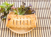 Pineapple pie and lettuce in wooden plate on wooden table Stock Photography