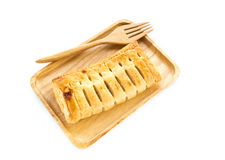 Pineapple pie in wooden plate on white background Stock Photo