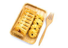Pineapple pie in wooden plate on white background Royalty Free Stock Photos