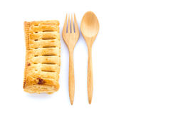Pineapple pie and wooden spoon on white background Royalty Free Stock Photo