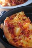 Pineapple pizza slice Stock Photo
