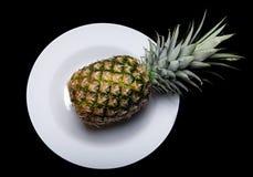 Pineapple on plate Stock Photo