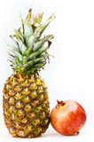 Pineapple and pomegranate isolated on white Stock Photos