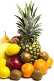 Pineapple, pomegranate, lemon, kiwi, pamela and pear in a pile on a white background 2 stock images