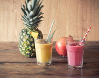 Pineapple and pomegranate smoothies Royalty Free Stock Images