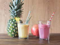 Pineapple and pomegranate smoothies Stock Image