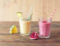 Pineapple and pomegranate smoothies Royalty Free Stock Photography