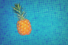 Pineapple and pool Stock Photo