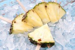 Pineapple popsicle yummy fresh summer fruit sweet dessert wood teak. Pineapple popsicle yummy fresh summer fruit sweet dessert on vintage old wood teak blue Stock Images