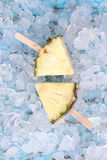 Pineapple popsicle yummy fresh summer fruit sweet dessert wood teak. Pineapple popsicle yummy fresh summer fruit sweet dessert on vintage old wood teak blue Royalty Free Stock Photography