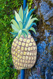 Pineapple on a post. A big pineapple on a post outdoors Royalty Free Stock Images