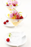 Pineapple punch with cherry ice cream Royalty Free Stock Image