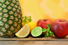Pineapple, red apples, lemons Stock Photo