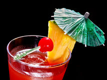 Pineapple red  cocktail with cherry and umbrella Stock Photos