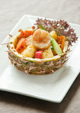 Pineapple rice. Rice with various ingredients served in cut pineapple Stock Photography
