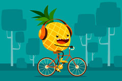 Pineapple riding bicycle in the park Stock Photography