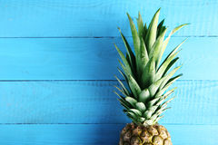 Pineapple. Ripe pineapple on a blue wooden table Royalty Free Stock Images