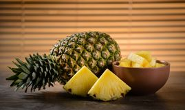 Pineapple. Ripe pineapple cut into slices on wooden table Stock Photography