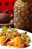 Pineapple salad. On a dish on a background of the big pineapple stock images