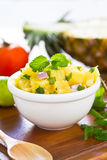 Pineapple salsa. In a small bowl by fresh pineapple ,lime Royalty Free Stock Image