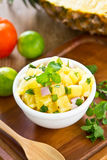 Pineapple salsa. In a small bowl by fresh pineapple ,lime Royalty Free Stock Photography