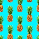 Pineapple seamless pattern on blue background Royalty Free Stock Photos