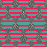 Pineapple seamless pattern on stripe background Royalty Free Stock Photo