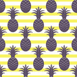 Pineapple seamless pattern on stripe background Stock Image