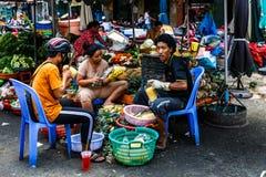 Pineapple sellers at Xom Chieu Market, Saigon, South of Vietnam. Pineapple sellers at Xom Chieu Market, District 4, Saigon, South of Vietnam royalty free stock photography