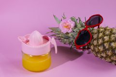 Pineapple series with sunglasses on yellow blue and pink background. stock image