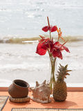 Pineapple, shell, flowers on a beach table Royalty Free Stock Photography