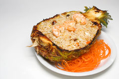 Pineapple Shrimp Fried Rice. In hollow pineapple shell with carrot strings Royalty Free Stock Images