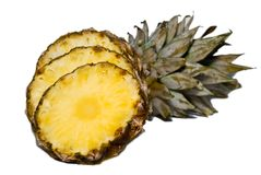 Pineapple slices. Cut into slices pineapple on a white background Royalty Free Stock Photos