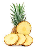 Pineapple and slices Royalty Free Stock Images