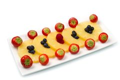 Pineapple slices with berries Royalty Free Stock Image