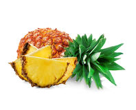 Pineapple with slices close-up  on white background Royalty Free Stock Photos