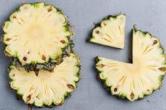 Pineapple slices  on dark rock Stock Image