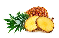 Pineapple with slices isolated Stock Images