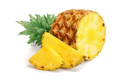 Pineapple with slices isolated on white background.  royalty free stock image