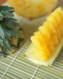 Pineapple with slices. Fresh of pineapple slices Asian-style on the bamboo place mats background. Tropical fruit concept. Selective focus Stock Image