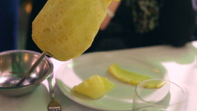 Pineapple slices with sword stock video footage