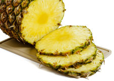 Pineapple. Slices of pineapple on white background Stock Images