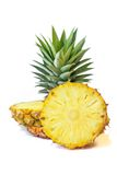 Pineapple with slices on a white background, Fruit. Royalty Free Stock Photography