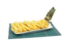 Pineapple slices in white porcelain plate Stock Photo