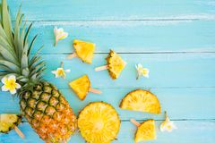 Pineapple slices on wood plank blue color. Stock Photos